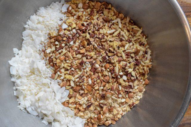 Homemade granola ingredients in metal bowl
