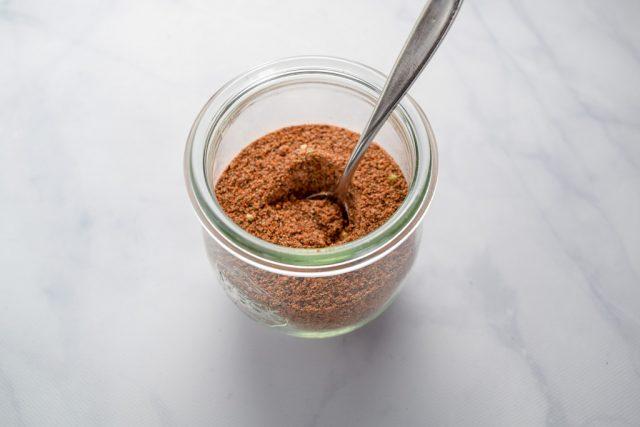 homemade taco seasoning in glass jar with spoon