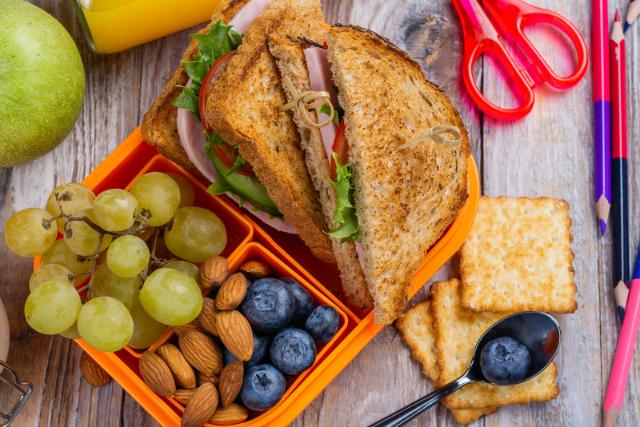 sandwich, fruit, nuts in school lunch