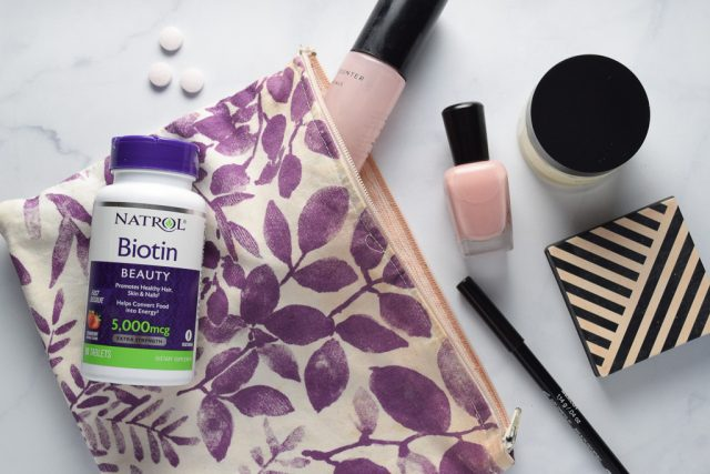 Natrol Biotin supplement and cosmetics bag