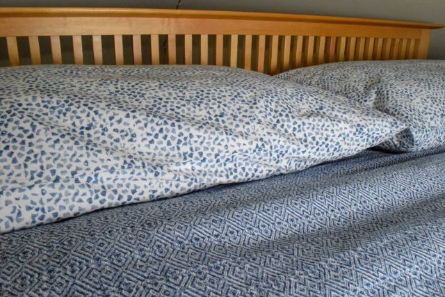 Organic cotton sheets and pillows on bed