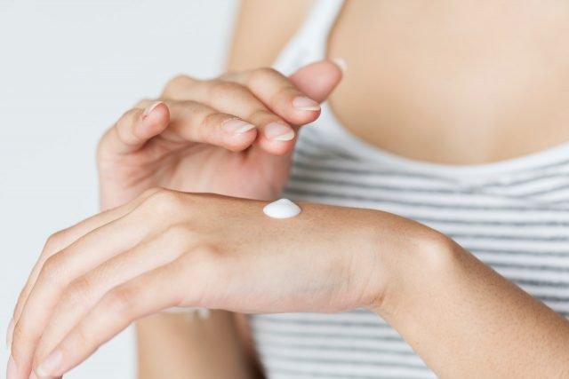 lotion on hands - top ingredients to avoid in skin care