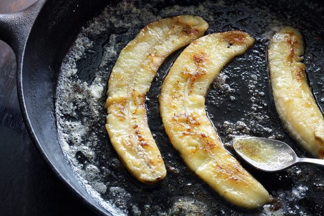 Fried bananas in a non-stick cast iron pan