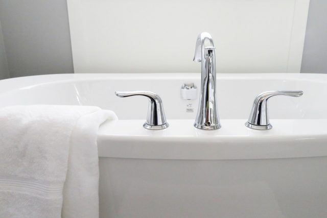 white bathtub and towel