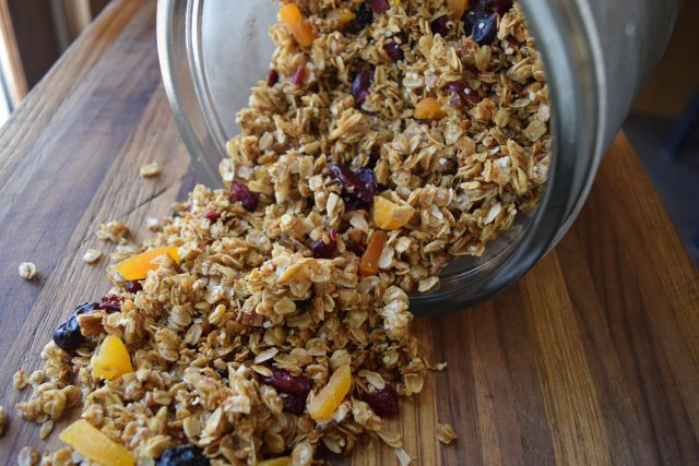 homemade granola coming out of jar